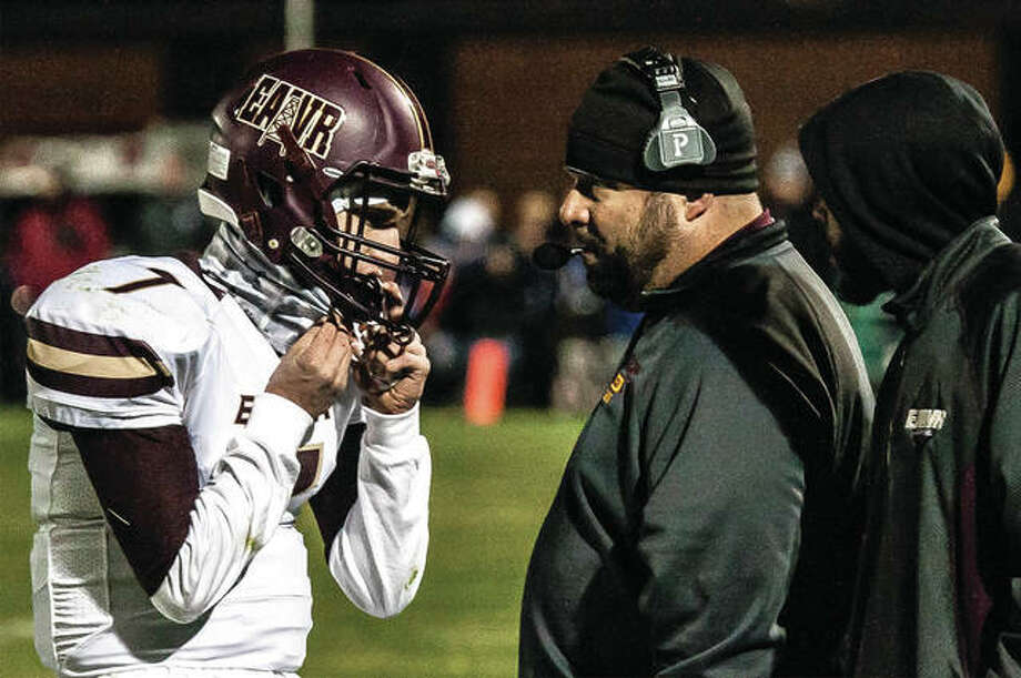 EA-WR coach Garry Herron talks with QB Justin Englar during last Friday's Class 3A playoff game at Carlinville. The Cavs beat the Oilers 52-19 to end EA-WR's season at 7-3. Photo: Nathan Woodside / For The Telegraph