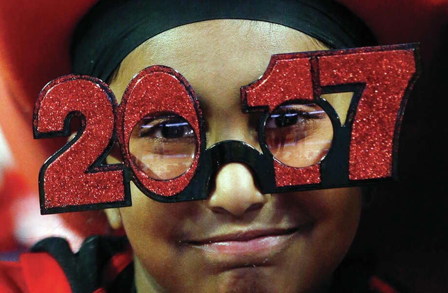 Nam Y. Huh | AP Chicago Bulls fan Ajay Singh, 9, wears 2017 glasses before the team's New Year's Eve game against the Milwaukee Bucks in Chicago.