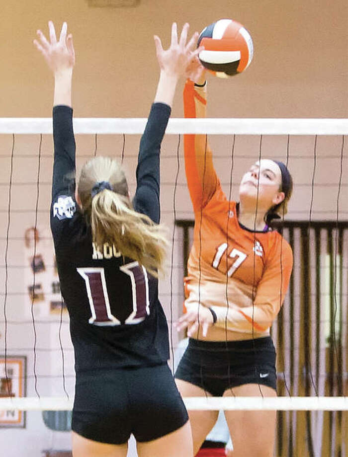 Edwardsville's Rachel Pranger, shown hitting past the block of Belleville West's Katherine Koch (11) during a Tigers' SWC win on Oct. 17 in Edwardsville, and the Tigers played Minooka on Friday night in the Normal West Class 4A Super-Sectional. Photo: Scott Kane | For The Telegraph