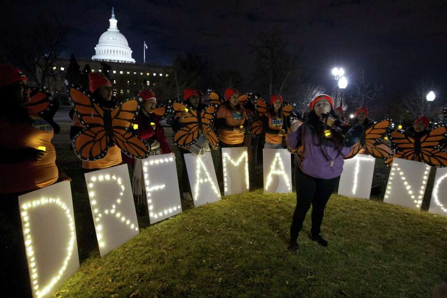 "Demonstrators chant in support of Deferred Action for Childhood Arrivals (DACA) during a rally outside the Capitol on Jan. 21. The president's proposal on this has been decried as ""amnesty."" Photo: Jose Luis Magana /Associated Press / FR159526 AP"