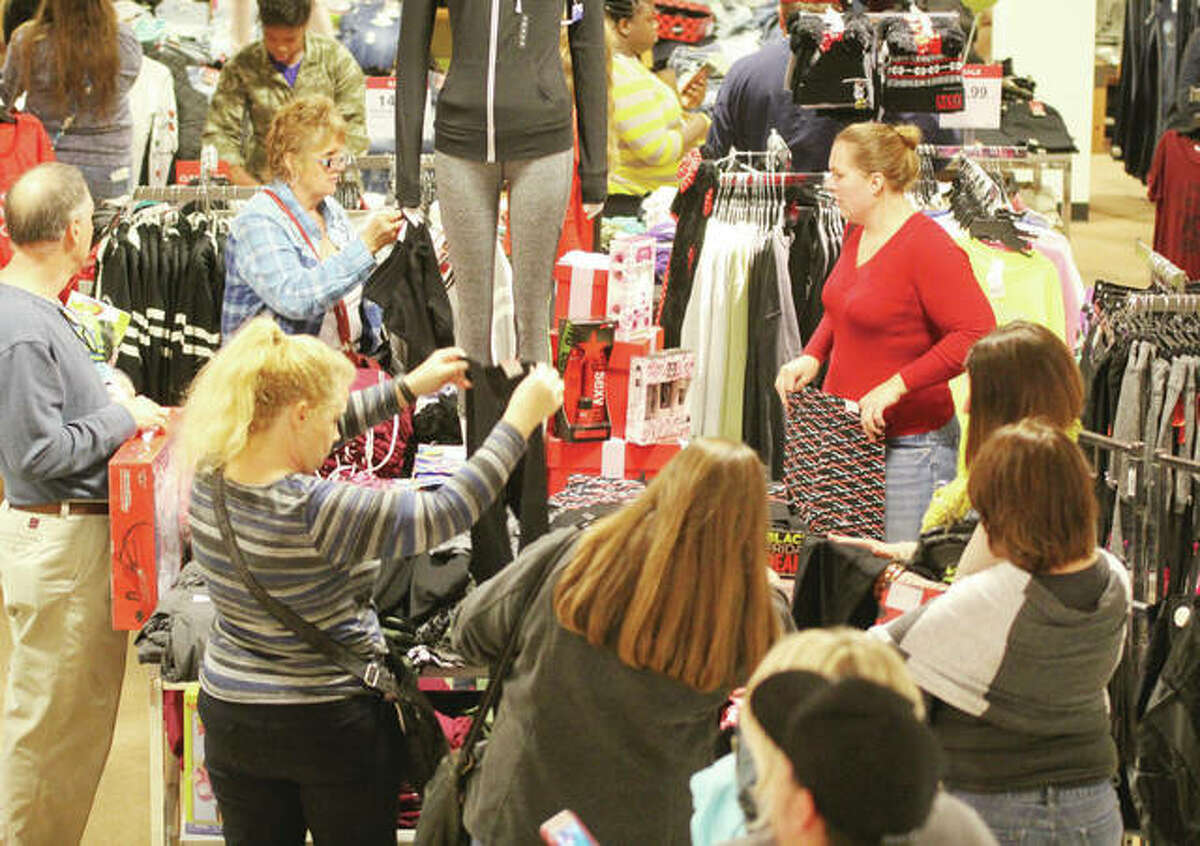 Holiday shoppers look for bargains at the Alton Square JC Penney store last year. A survey by the National Retail Foundation says shoppers are going to be spending about 3.4 percent more on Christmas this year.