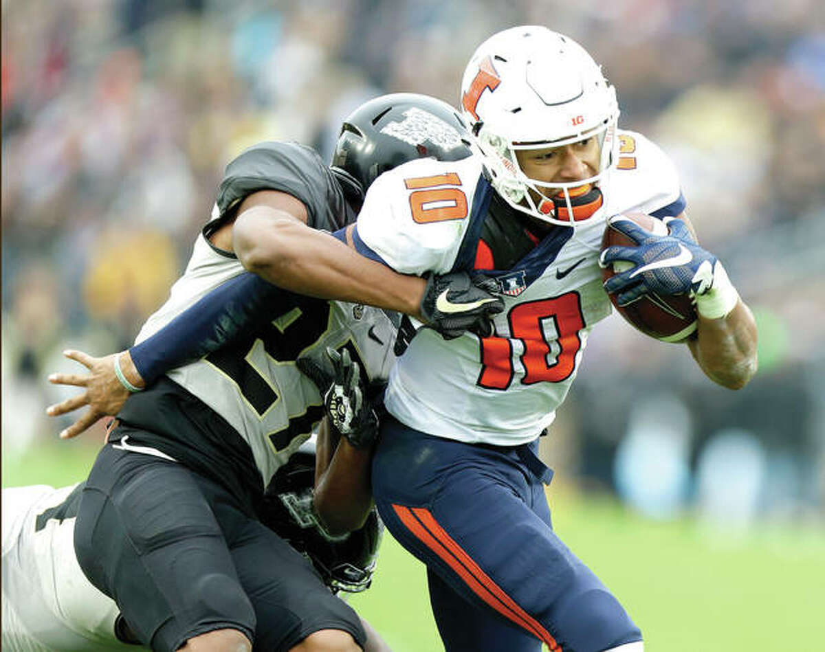 Illinois quarterback Cam Thomas (10) is tackled by Purdue safety Navon Mosley (27) Saturday in West Lafayette, Ind..
