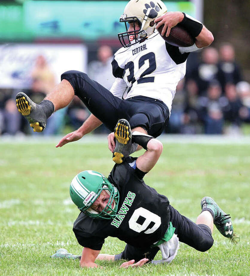 Carrollton's Zach Flowers stops Camp Point Central's Cole Williams during a game Saturday at Carrollton. Photo: Dennis Mathes, Journal-Courier | For The Telegraph