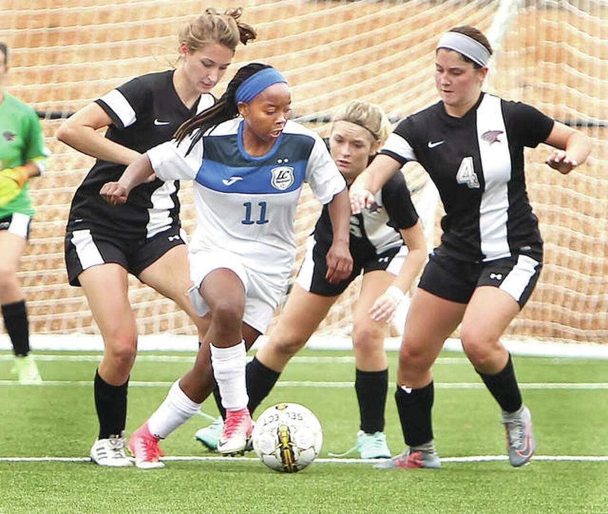 LCCC's Senate Letsie (11) controls the ball against St. Charles Community College Saturday during district playoff action at the Missouri Rush Soccer Complex. Letsie scored the game-winning goal in the Trailblazers' 2-1 victory, which means a berth in the NJCAA National Tournament.