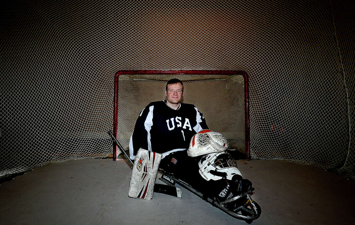 Kyle Huckaby has a net and synthetic ice surface set up in the garage of his family's home in Port Arthur. There, he can practice his skills as a goalie for the gold medal winning USA sled hockey team. Huckaby was born with a spinal cord disorder that prohibits use of his legs, but as a member of the sled hockey team, he is able to continue the family tradition of hockey success. Photo taken Friday, February 9, 2018 Kim Brent/The Enterprise