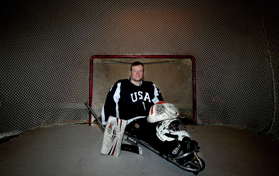 Kyle Huckaby has a net and synthetic ice surface set up in the garage of his family's home in Port Arthur. There, he can practice his skills as a goalie for the gold medal winning USA sled hockey team. Huckaby was born with a spinal cord disorder that prohibits use of his legs, but as a member of the sled hockey team, he is able to continue the family tradition of hockey success.  Photo taken Friday, February 9, 2018 Kim Brent/The Enterprise Photo: Kim Brent / BEN