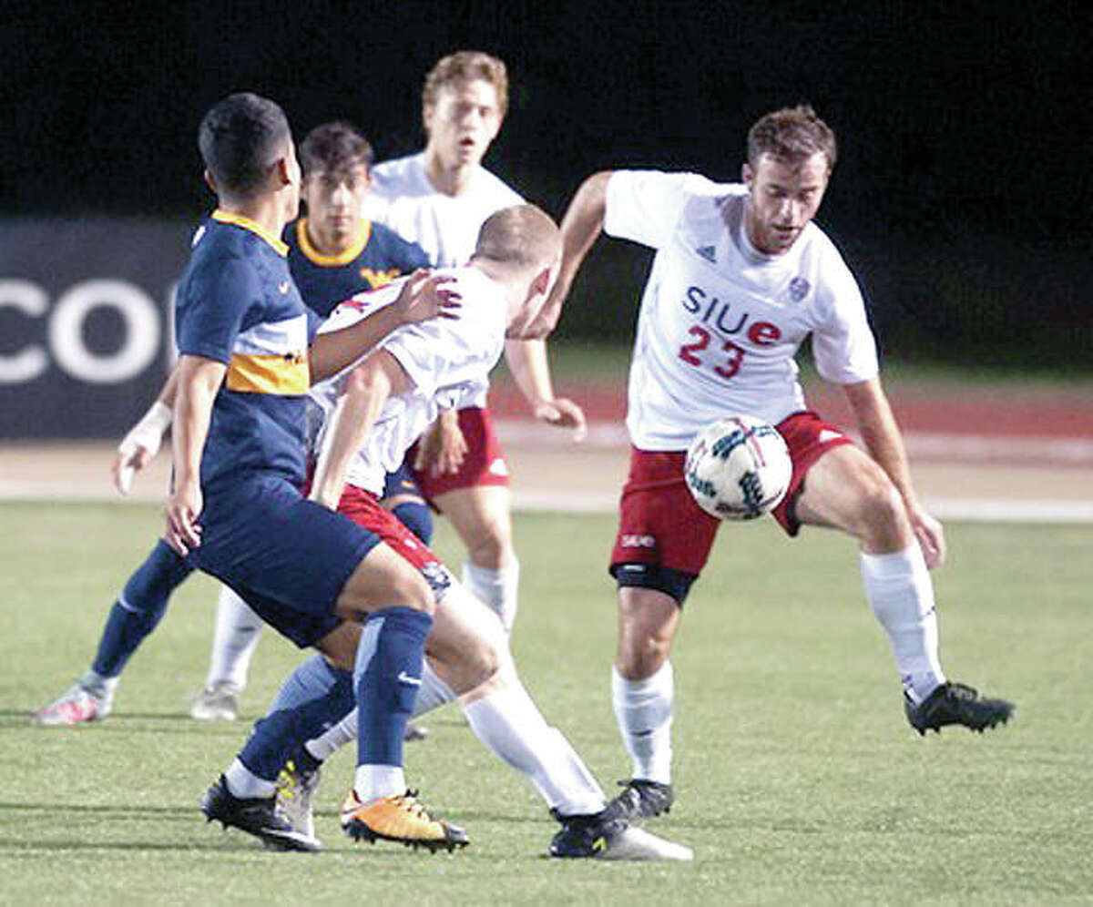 SIUE's TC Hull (23) settles the ball in action against West Virgnia Saturday night at Korte Stadium. The Cougars lost 2-1 in overtime.