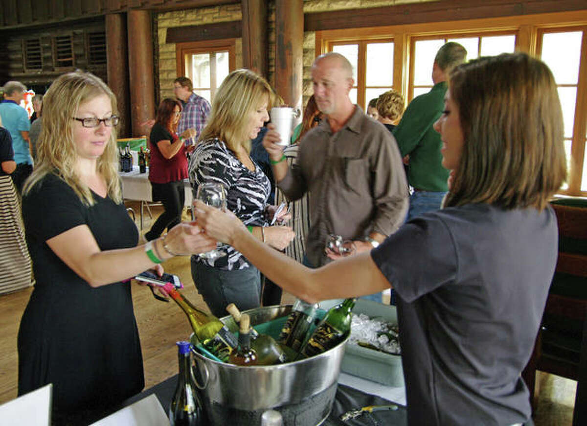 Katrina Bearth of Belleville samples wine on Sunday at Pere Marquette.