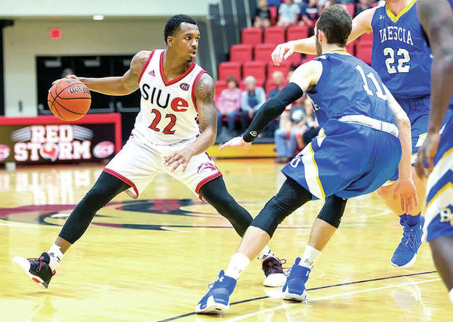 SIUE's Justin Benton (22) controls the in Sunday's action against Brescia at the Vadalabene Center. Benton scored three points in SIUE's 95-75 victory. Photo: SIUE Athletics