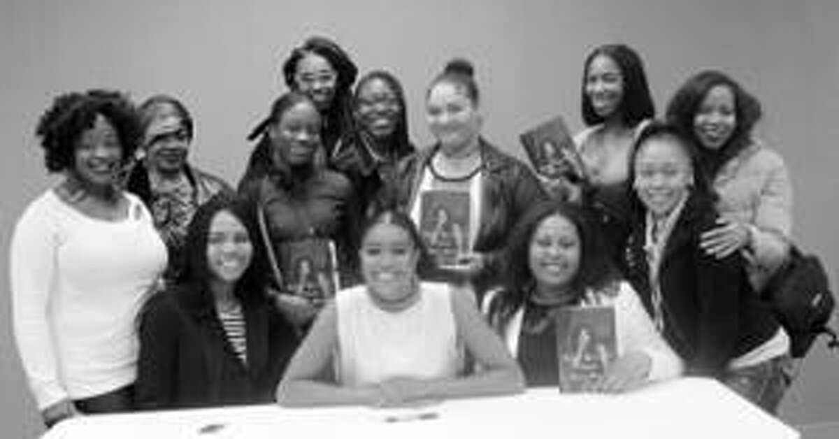 Actress and New York Times Best Selling Author Gabrielle Union (sitting center) spoke to a group of students from the SIUE East St. Louis Center Upward Bound Math and Science EC program, including Kayla Dawson (to her left). Also pictured are UBMS counselor Septembre Lewis (center back row) and founder of Shining Light Media Jamie Crockett (standing far right).
