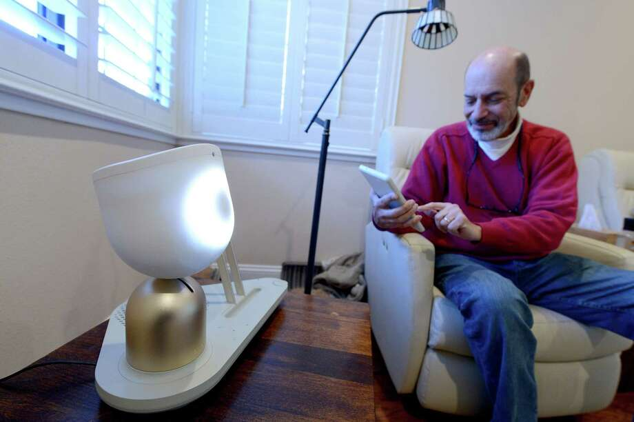 Barry Sardis interacts with ElliQ in his San Jose, California home on Friday, Jan. 26, 2018. ElliQ, which is currently in beta testing, is a smart speaker that is designed to cater towards the elderly and their needs. (Dan Honda/Bay Area News Group/TNS) Photo: Dan Honda, MBR / Bay Area News Group