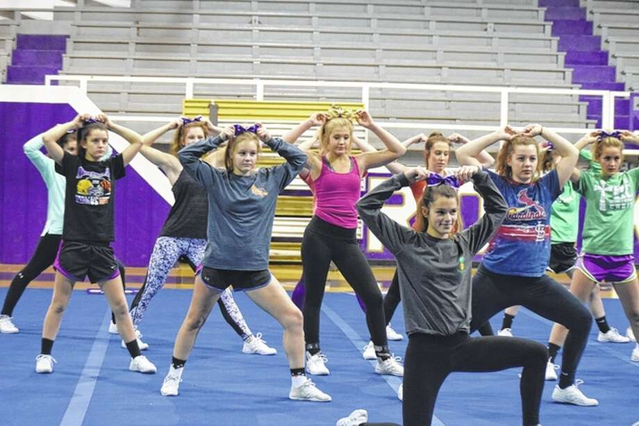 Routt Catholic High School's varsity cheer squad practices Friday before they headed to the state championships today in Springfield. The Routt squad is scheduled to perform at 1:45 p.m. Photo: Samantha McDaniel-Ogletree   Journal-Courier