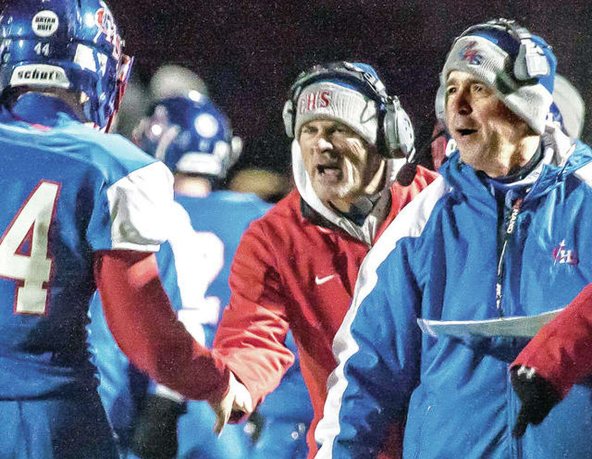 Carlinville assistant coach Don Borgini, center, and head coach Chad Easterday, right, shout encouragement during a recent playoff game. The Cavaliers will play host to Pleasant Plains at 2 p.m. Saturday in a quarterfinal round game of the IHSA Class 3A state football playoffs.
