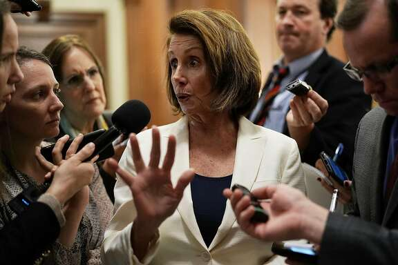 WASHINGTON, DC - FEBRUARY 07:  U.S. House Minority Leader Rep. Nancy Pelosi (D-CA) (C) speaks to members of the media after her long speech on immigration at the Capitol February 7, 2018 in Washington, DC. Pelosi exercised her power as minority leader and launched a filibuster-liked floor speech on Dreamers and urged Republicans to take action to solve their status before the March 5th deadline President Trump has set for the Deferred Action for Childhood Arrivals policy.  (Photo by Alex Wong/Getty Images)