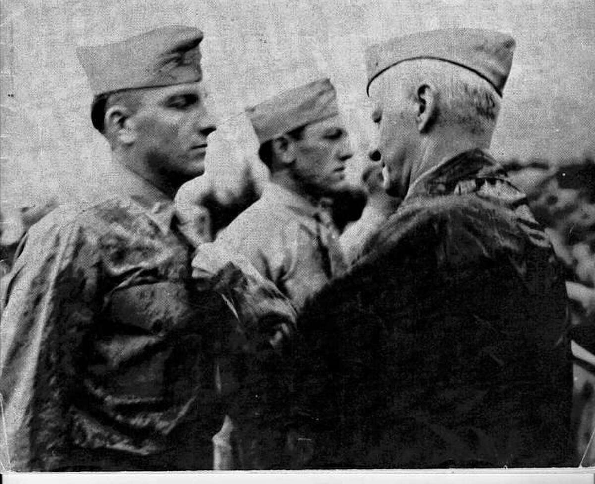 2nd Lt. Joseph J. Barr, former Judge for Madison County, '42, USMCR, receives Navy Cross from Admiral Chester W. Nimitz (LL.D., October, 1943), Commander of the United States Pacific Fleet for extraordinary heroism during action against enemy Japanese forces in Tarawa, Gilbert Islands, Nov. 20, 1943. Wounded in the face and right shoulder while in a landing craft, he, his right arm useless, continued to shore where he remained thirty-six hours, disregarding his own needs, to organize and lead his platoon. His courage and valor were an inspiration to the men around him and were in keeping with the highest traditions of the United States Naval Service.
