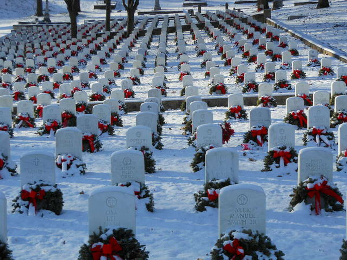 """Wreathes mark graves of veterans after a previous, """"Wreathes Across America"""" ceremony at Alton National Cemetery."""