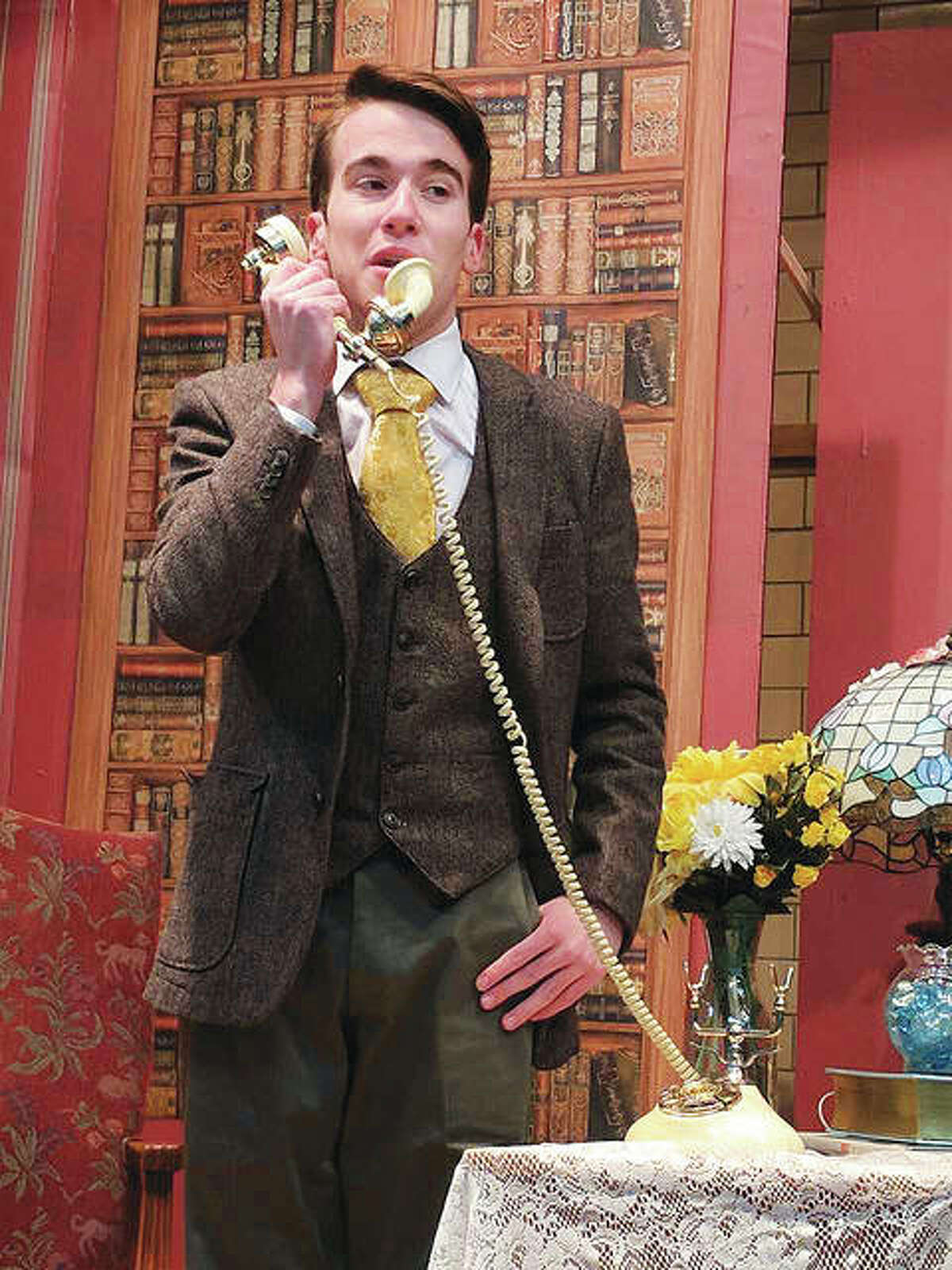 """Elwood P. Dowd (Joseph File) accepts magazines subscriptions from a telephone sales agent and then invites the female agent over to his house to join his sister's society party in MCHS' production of """"Harvey."""""""