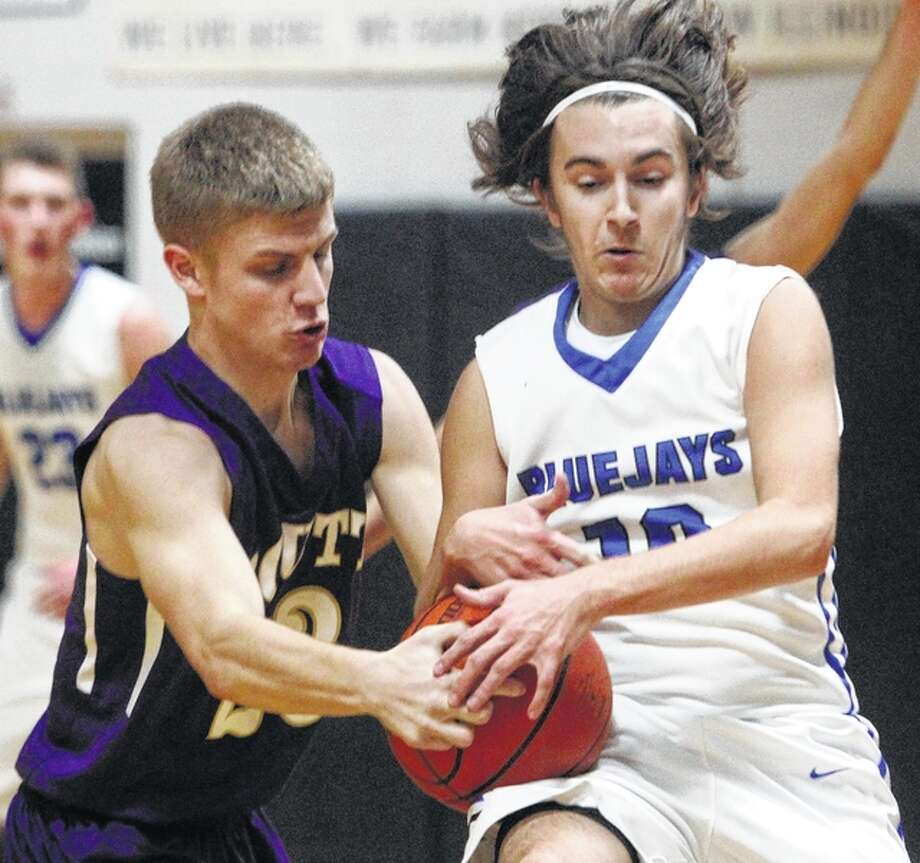 Tyler Jones goes for a steal during a game against Routt at the Winchester Invitatational Tournament Monday night. Photo: Dennis Mathes | Journal-Courier