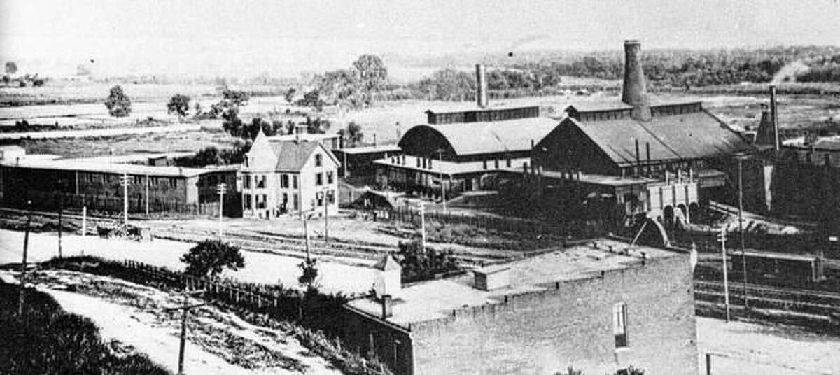 By September, 1882, Illinois Glass employed 425 men and boys, with a payroll of $4,000 per week. A new furnace was added in 1887, making a total of five furnaces with 900 employees. The firm seemed to have unlimited potential for success, due to the efficient production and management techniques and enlightened marketing principles of Levis and Smith. Expansion continued at a rapid pace. Fire was a constant threat, and many fires destroyed portions of the plant over the years. The city of Alton provided horse drawn fire equipment for the factory. It was housed in the building seen in the foreground, just below Fourth Street, then unpaved. Flooding also caused an occasional disruption of business.