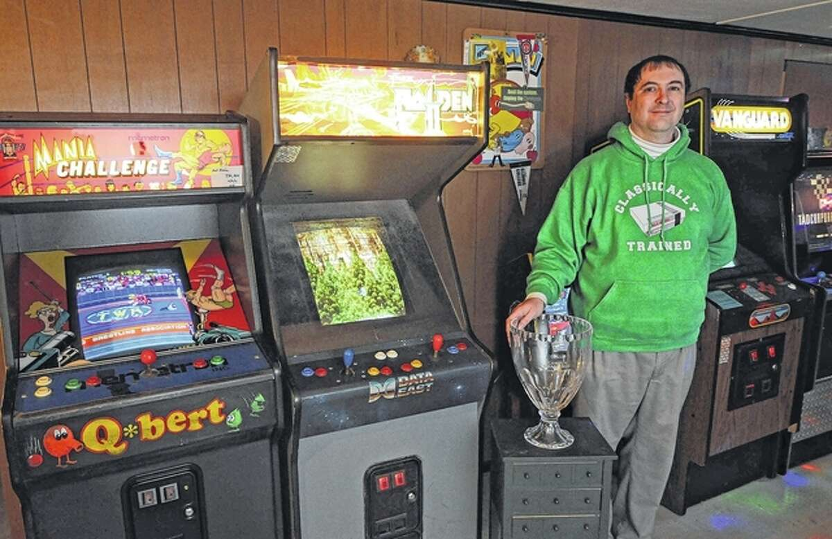 The trophy Steven Lucas won 25 years ago in a national video-game competition has a place of honor among the arcade games in the basement of his house.