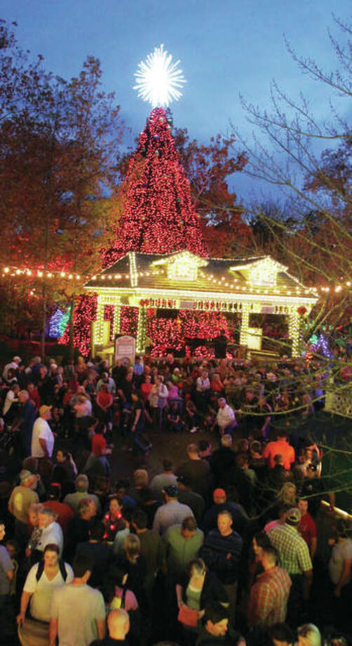 "People watch the lighting of the five-story Christmas tree at Silver Dollar City in Branson, Missouri. The Christmas season runs now through Saturday, Dec. 30, at the theme park, and is part of the larger ""Ozark Mountain Christmas"" in Branson. Photo: Scott Cousins