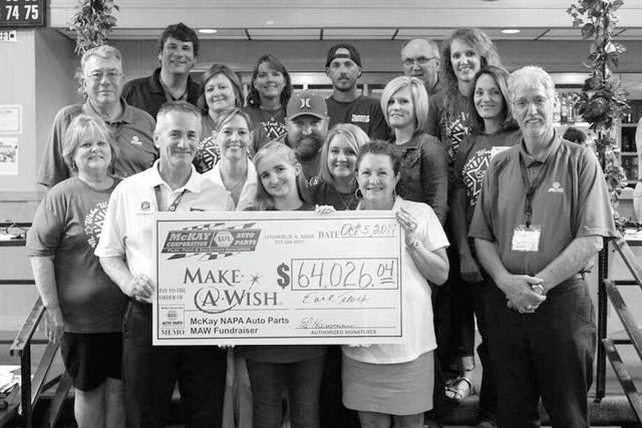 Left to right: Earl Flack, President, McKay NAPA Auto Parts; Grace Hassard, 14, 'Wish Child'; Kathy Eames, Make-A-Wish Volunteer; Norman May, Outside Sales Manager, McKay NAPA. Row two: Sue Miller, McKay NAPA Promotions Coordinator & Executive Assistant; Kathy Neville, Make-A-Wish Volunteer; Jerilyn Hassard, Staunton, Grace's Mother. Row three: Jim McKay, McKay Corporation; Bart Hassard, Staunton, Grace's Father; Casey Logsdon, Accounts Payable and Peggy Snell, Office Manager, McKay NAPA Auto Parts. Row four: Ryan Ocepek, Operations Mgr./IT and Toni White, Accts. Payable, both of McKay NAPA; Josh Ronco of Ronco's Auto Body, Collision Repair & Custom Shop, Litchfield, designer of the McKay NAPA 2017 Ford Bronco Make-A-Wish Benefit Cart; Ed Hammann, Vice President, and Alex Carter, both of McKay NAPA Auto Parts.