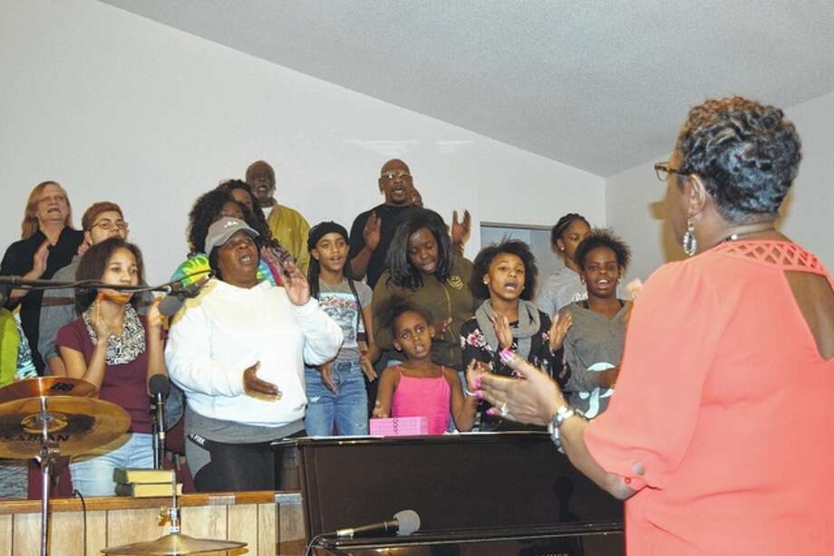 Regina Nichols leads the Community Choir Wednesday as it rehearses for Monday's Martin Luther King Day program at Mount Emory Baptist Church.