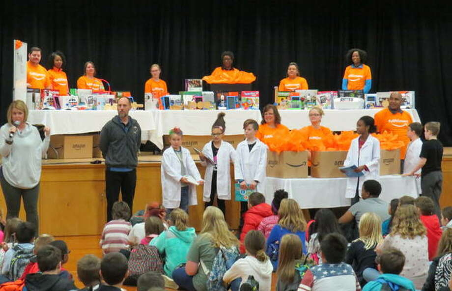 Amazon employees show Woodlawn Elementary students the $10,000 of STEM equipment the company donated to the school. Photo: For The Telegraph