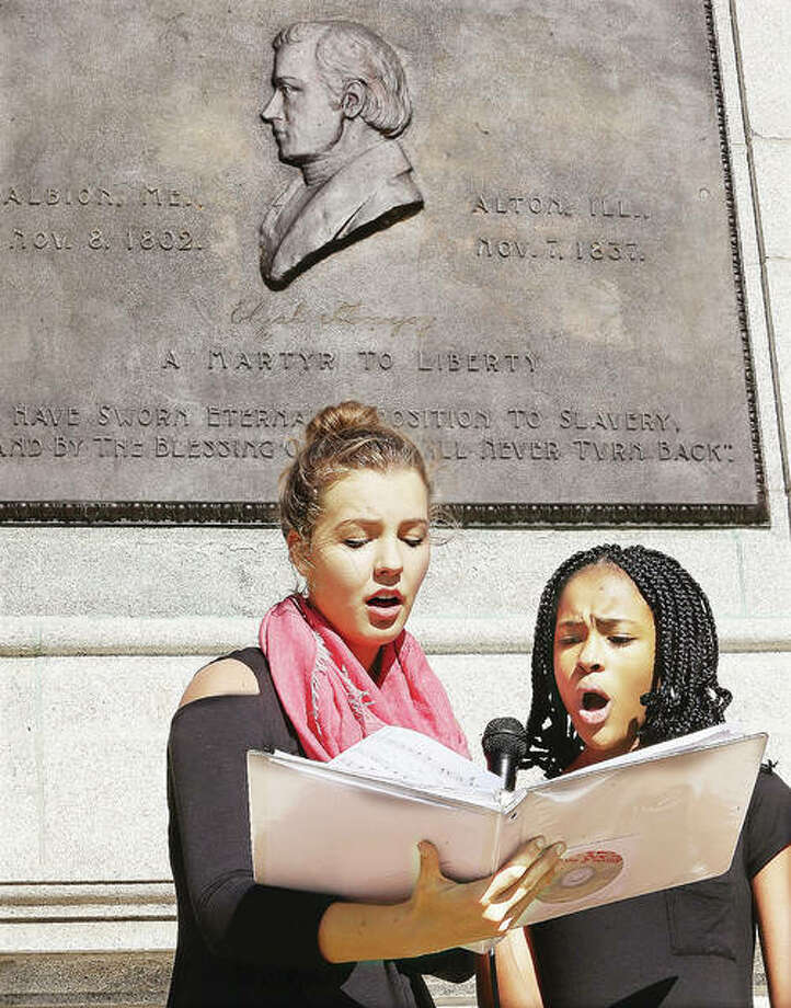 "Alton High School students Audrey Neace, left, and Ty'Ria Rounds sing ""Great is Thy Faithfulness"" Thursday during the annual Lovejoy Day ceremony held at the Lovejoy Monument in Alton for the anti-slavery press martyr. Photo: John Badman