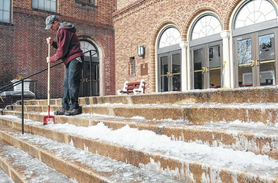 David McKeown | Republican-Herald (AP) John Verchick, a custodian at the Pottsville Area School district in Pennsylvania, chips ice away on stairs in front of the high school Wednesday as that area deals with an ice storm. A storm system that has been brewing in the west is expected to bring rain, sleet and ice to west-central Illinois starting today.