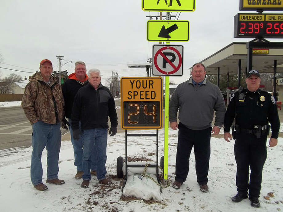 Meredosia Chief of Police Curtis Williams worked with several groups to get a radar speed limit sign near the school crossing zone to help reduce potential for accidents. The village, the school and Halverson Construction each paid a third of the cost of the sign, which is shown by Village Board member David Werries (from left), Scott Halverson of Halverson Construction, Mayor Jim Rausch, Meredosia-Chambersburg school Superintendent Thad Walker and Williams.