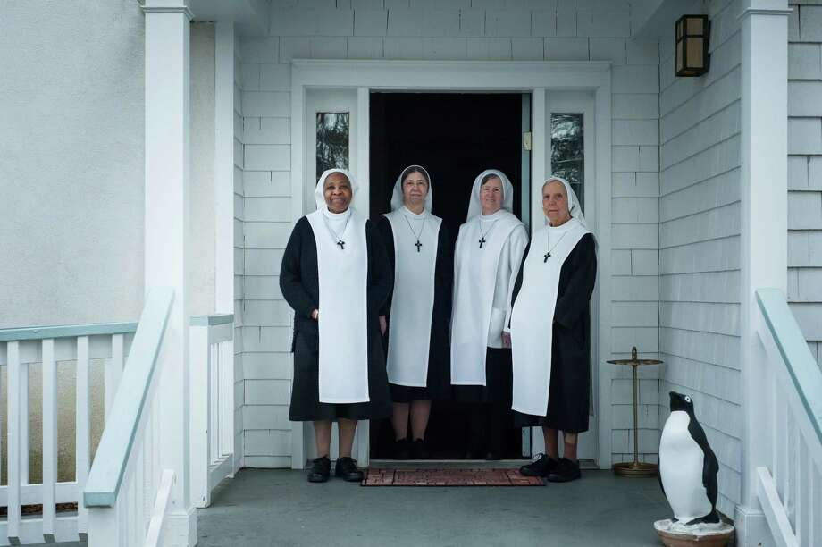 From left: Sister Mary Angela, Sister Mary Linda, Sister Marie Aimé and Sister Mary Francis at their convent. The sisters are embroiled in a dispute over a proposed affordable housing development next to their convent. Photo: KHOLOOD EID, STR / NYTNS