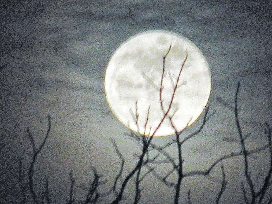 A bright full moon makes its first appearance of the new year over west-central Illinois. Photo: Beverly Watkins | Reader Photo
