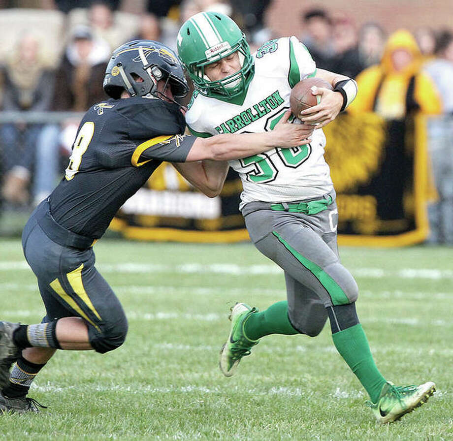 Carrollton's Tyler Barnett tries to break away from a tackler during a game against Tuscola in the IHSA Class 1A state football playoffs Saturday in Tuscola. Photo: Dennis Mathes, Journal-Courier | For The Telegraph