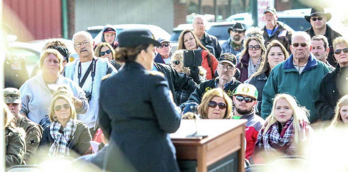 Hundreds who attended Saturday's dedication of East Alton's new Veterans Memorial Park listen intently to keynote speaker Lt. Col. Sarah Smith, an associate judge and military judge from Edwardsville. There are plans to grow the park that includes a brick memorial.