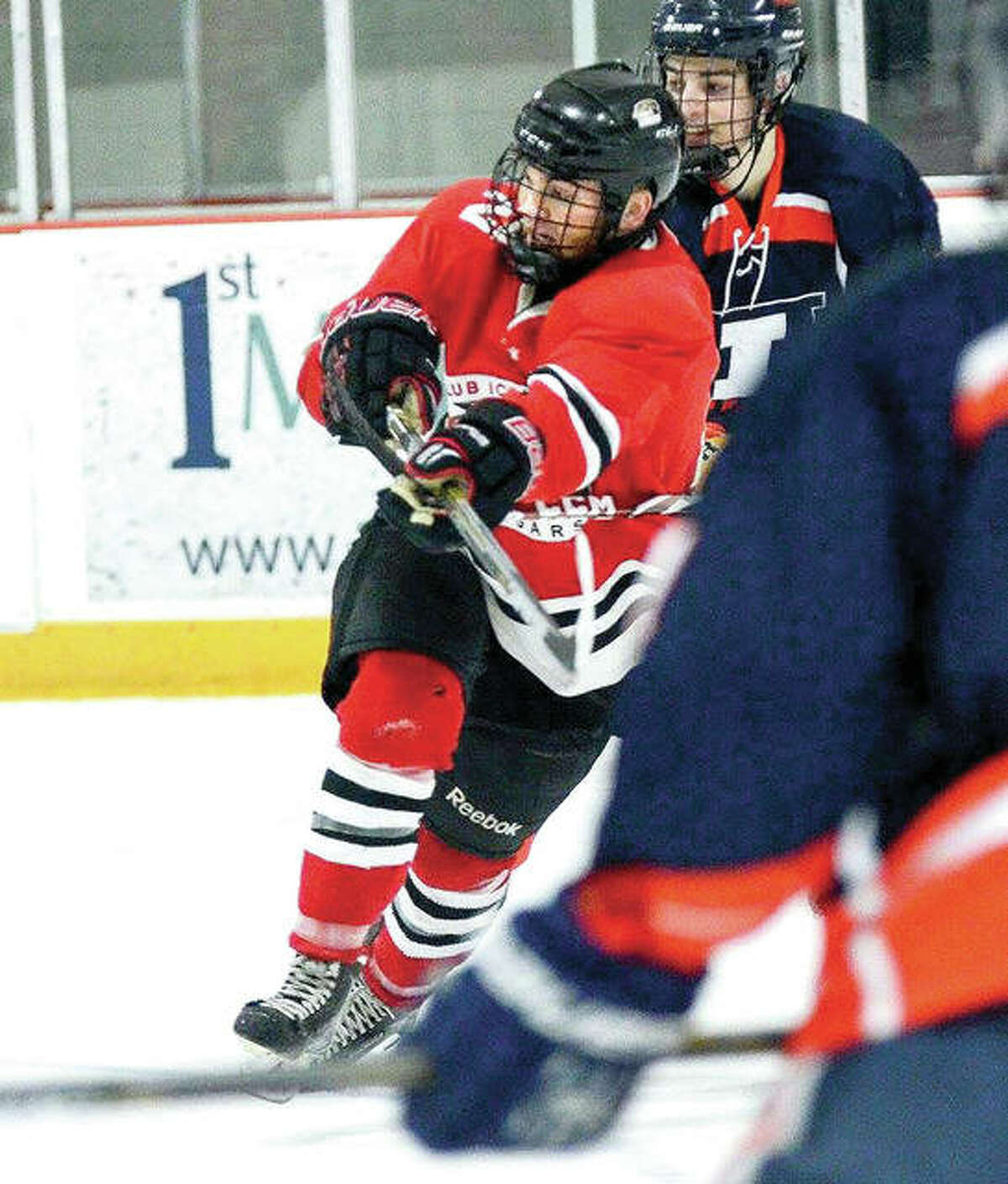 SIUE's Tyler Gilleland, left, scored three goals to lead his team to a 7-3 victory over Saint Louis University in the Veterans Day Game at the east Alton Ice Arena. Gilleland, a Southwestern high grad, is shown in actin earlier this season against the University of Illinois.