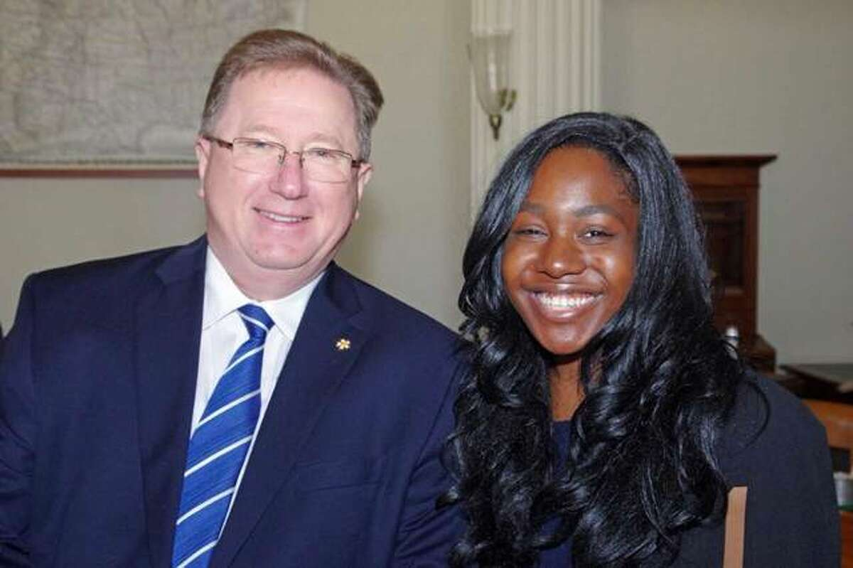 Lincoln Academy Regent Dennis Lyle, executive director of the Illinois Broadcasters Association, poses with Keelah Washington, the Student Laureate from Southern Illinois University Edwardsville.