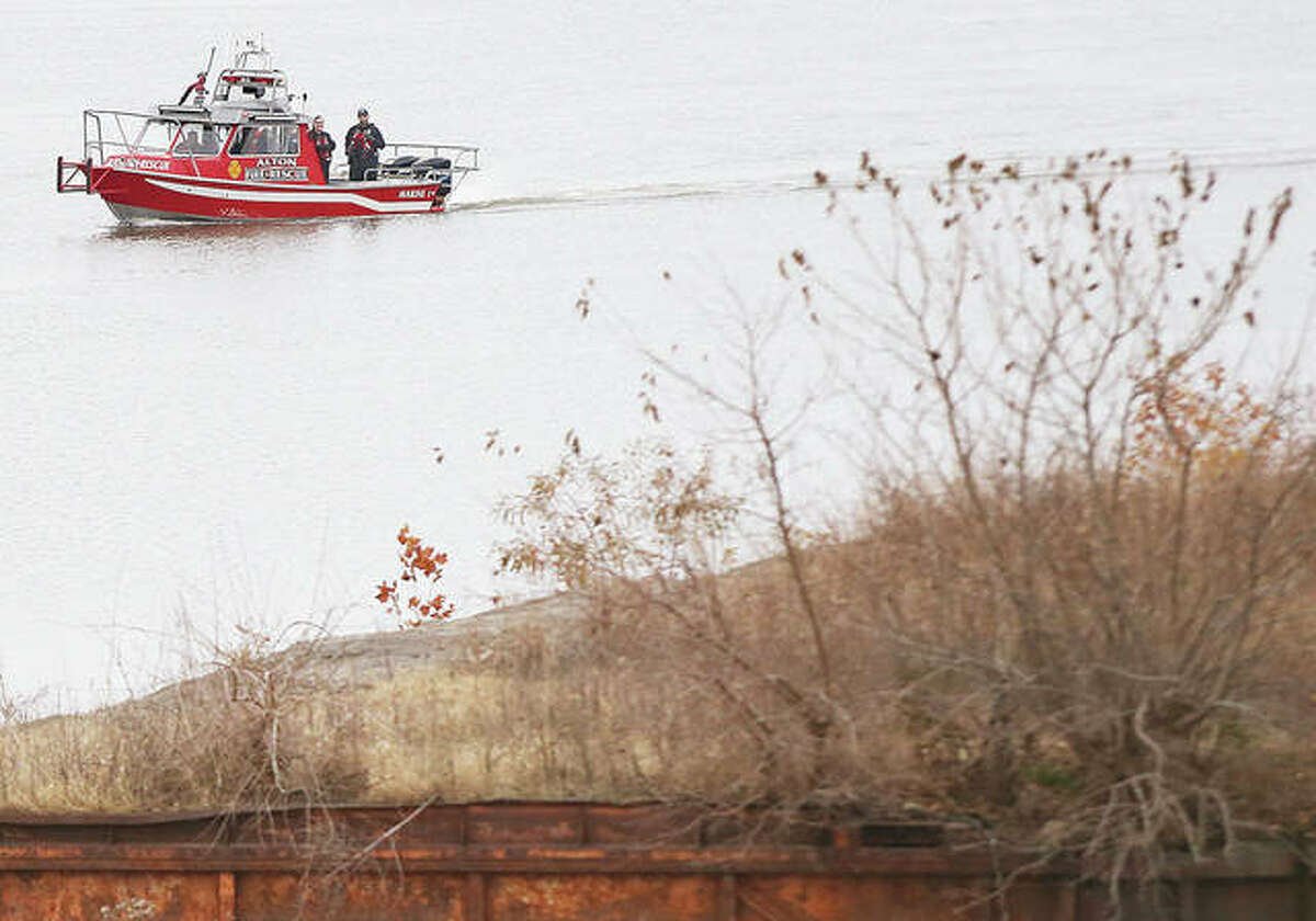 Alton Fire Department's Marine 1, fire and rescue boat, scans the Alton shoreline, with police officers aboard, before sunrise Monday after a male subject apparently jumped or fell into the river from the lock wall in Riverfront Park about 1:15 a.m. Monday. A rescue boat from the Argosy Casino had eyes on the subject in the water before he disappeared. Articles of clothing were recovered on shore and a woman met firefighters as they arrived at about 1:20 a.m. to take out Marine 1 from the Alton Marina, that the subject in the water was allegedly her son. Police from the Illinois Department of Natural Resources were expected to take over the search today.