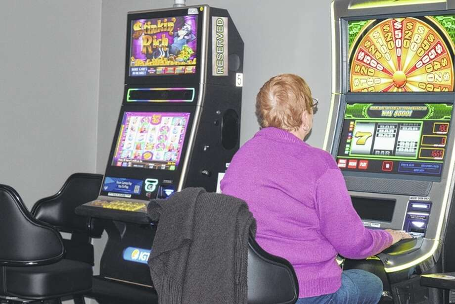A woman plays a video gaming machine Tuesday at the new Maxamillions Video Poker & Slots business at 2126 E. Morton Ave. Photo: Greg Olson | Journal-Courier