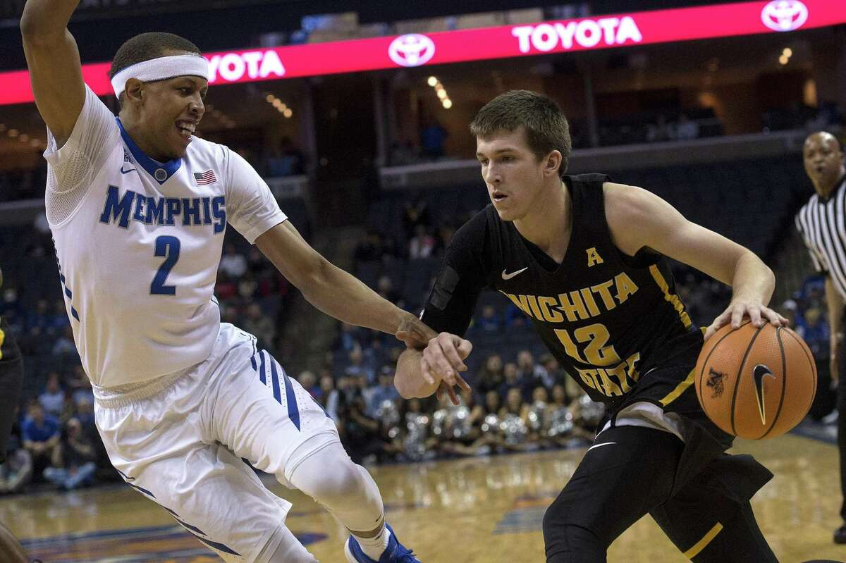 Wichita State guard Austin Reaves drives against Memphis forward Jimario Rivers on Feb. 6. Reaves and the Shockers host UConn tonight.