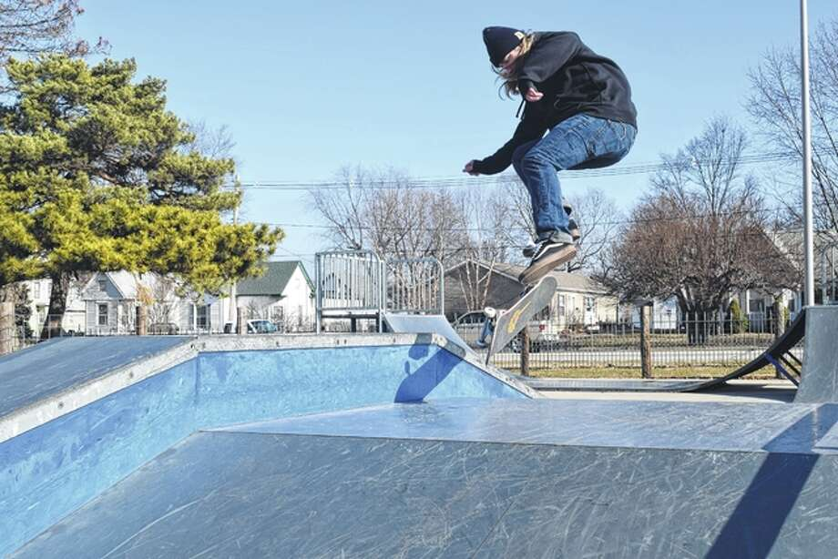 Ty Broyles of Jacksonville took advantage of Wednesday's unseasonably warm weather to practice a skateboarding trick at the skate park in Community Park. Photo: Greg Olson | Journal-Courier