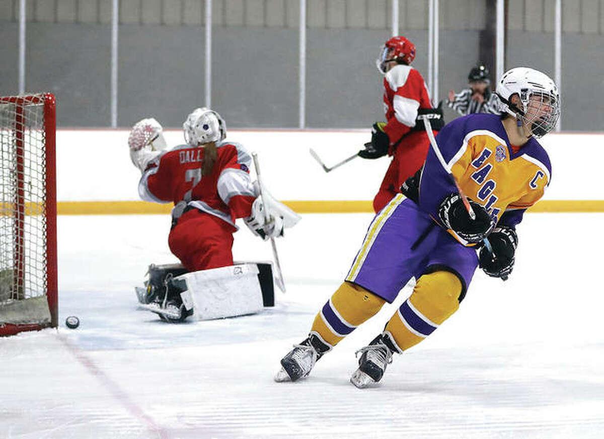 Bethalto's Michael Dixon, right, scores a goal past Alton goalkeeper Maddie Dallas during Monday night's MVCHA game at East Alton Ice Arena. Bethalto won 5-3.