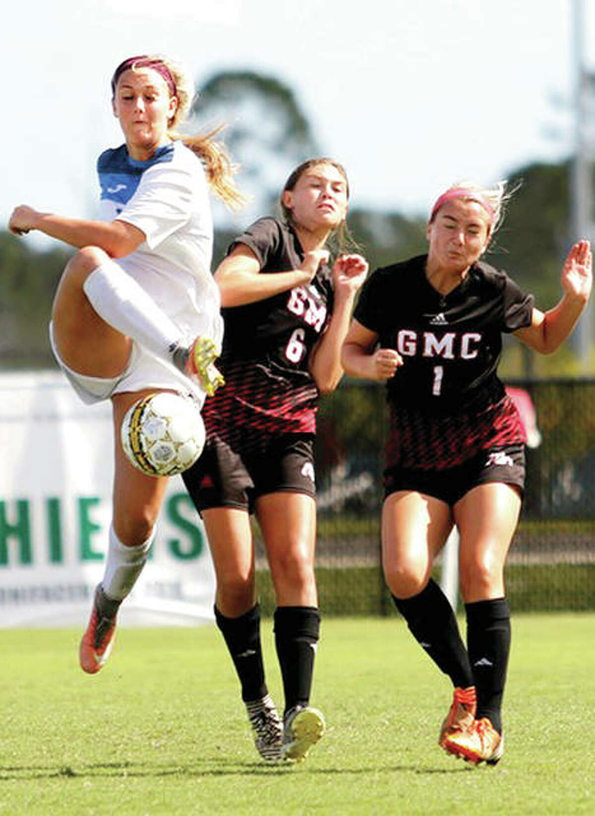 LCCC's Kassidy Louvall, left, gets off a shot in Tuesday's game against Georgia Military College at the NJCAA National Soccer Tournament in Melbourne, Fla. At right at GMC's Alison Rugel (6) and Ellery Duck (1). Louvall scored two goals, including the golden-goal winner, in the Trailblazers' 3-2 overtime win.
