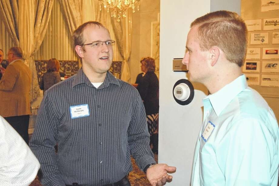 Justin McMurphy (left), manager of County Market and a member of the Jacksonville Area Chamber of Commerce board, speaks with Mitch Roberts, integrated solutions manager for Arends-Awe Inc. and a member of the chamber's Young Professionals Network, prior to the chamber's annual meeting Thursday night at Hamilton's.