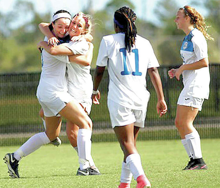Megan McDonald, left, hugs teammate Kassidy Louvall after Louvall scored a first-half goal Friday at the NJCAA National Tournament. Also pictured are LC's Senate Letsie (11) and Aivia Dubois. Photo: Eastern Florida State College