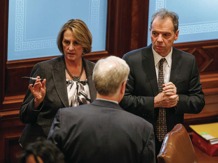 Justin L. Fowler | State Journal-Register (AP) Senate Minority Leader Christine Radogno (left), R-Lemont, talks with Senate President John Cullerton (right), D-Chicago, at the Capitol in Springfield. The Senate leaders are sticking to their work that they plan to vote on a compromise budget deal Wednesday.