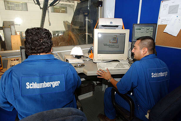 Employees Ivan Herbert and Efrain Montelongo with Schlumberger Drilling company in Reynosa, Tamaulipas use up to date technology used in the field for natural gas drilling in the Burrgos Basin. STAFF PHOTO BY DELCIA LOPEZ