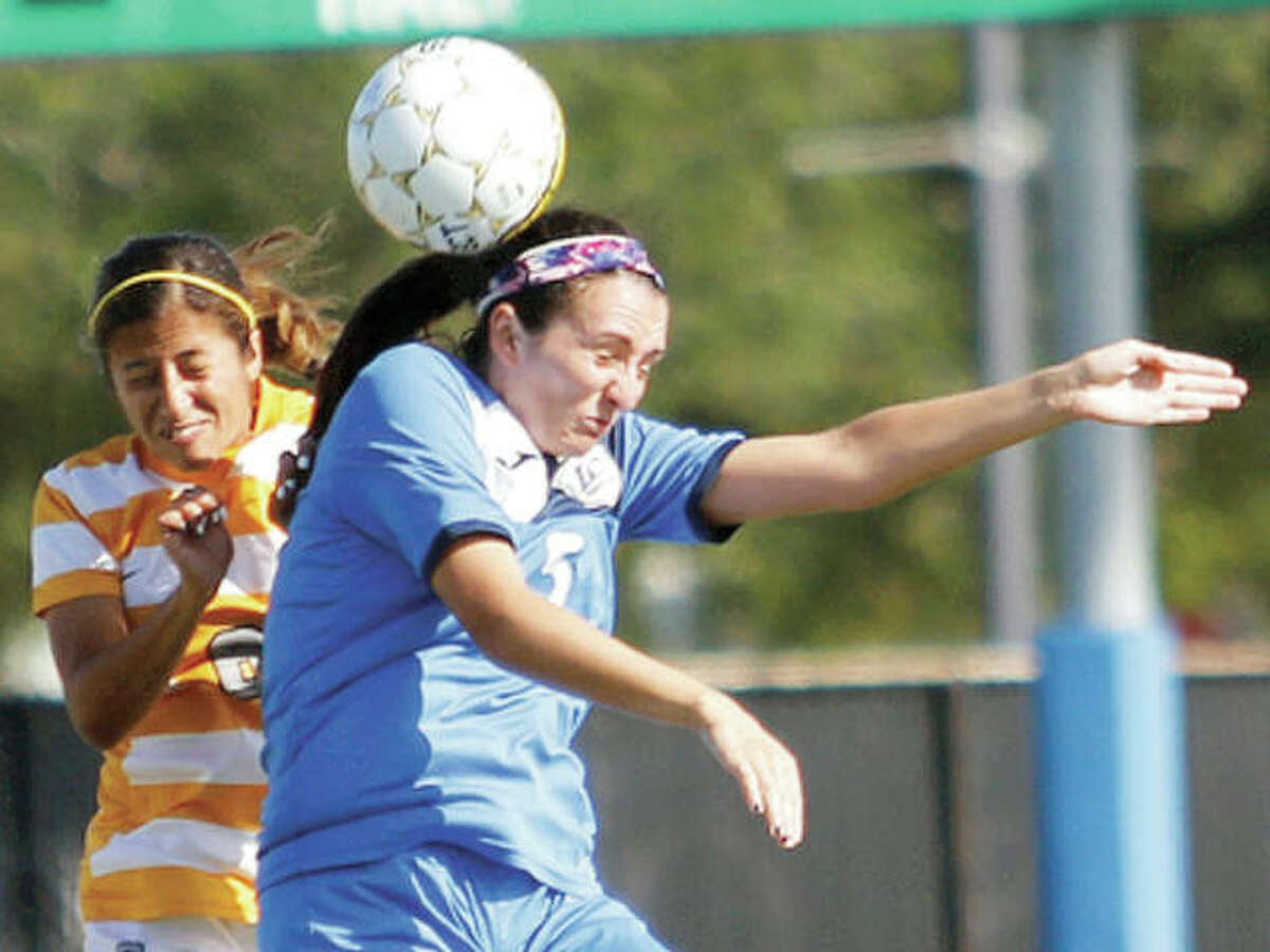 Megan McDonald of Lewis and Clark Community College, right, heads the ball while being challenged by Karina Ramirez during Wednesday's game in the NJCAA National women's Soccer Tournament in Melbourne, Fla.