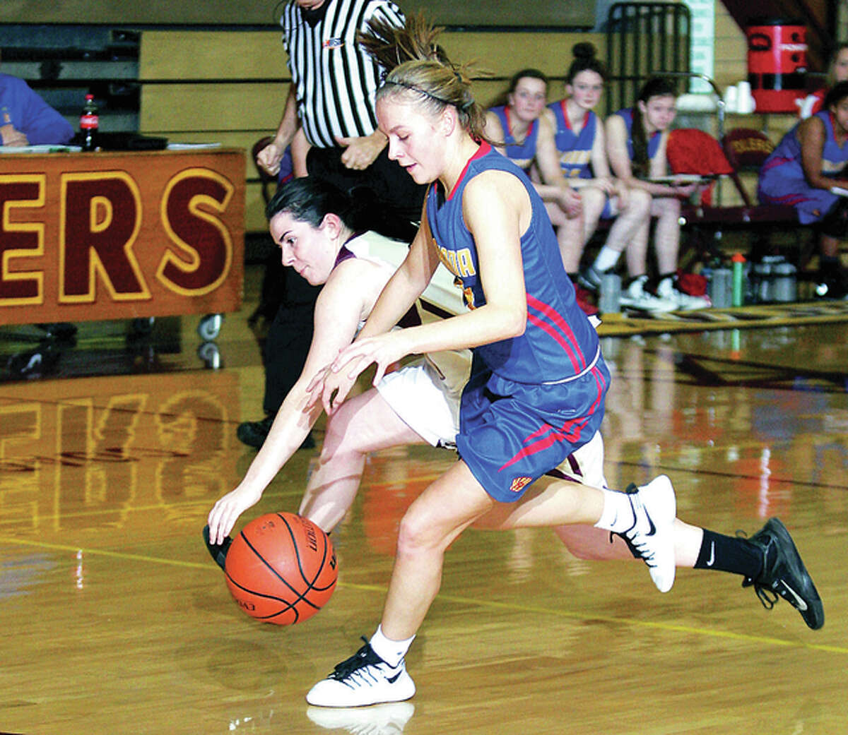 Roxana's Emma Lucas, right, scored 24 points in her team's 45-20 victory over Dupo Tuesday. She is shown in action last season against East Alton-Wood River.