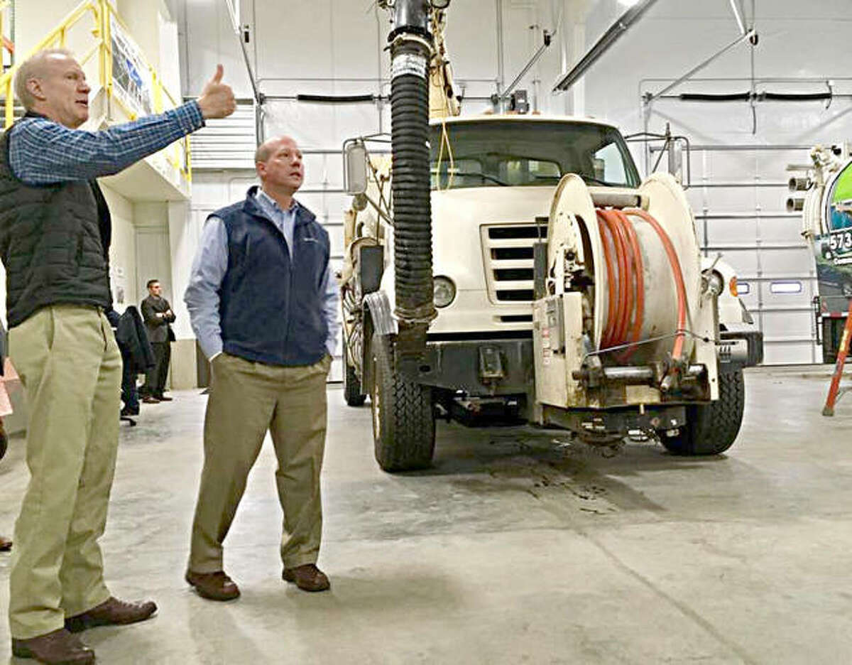 Illinois Gov. Bruce Rauner speaks Wednesday during his stop at EJ Equipment Co. in Troy.